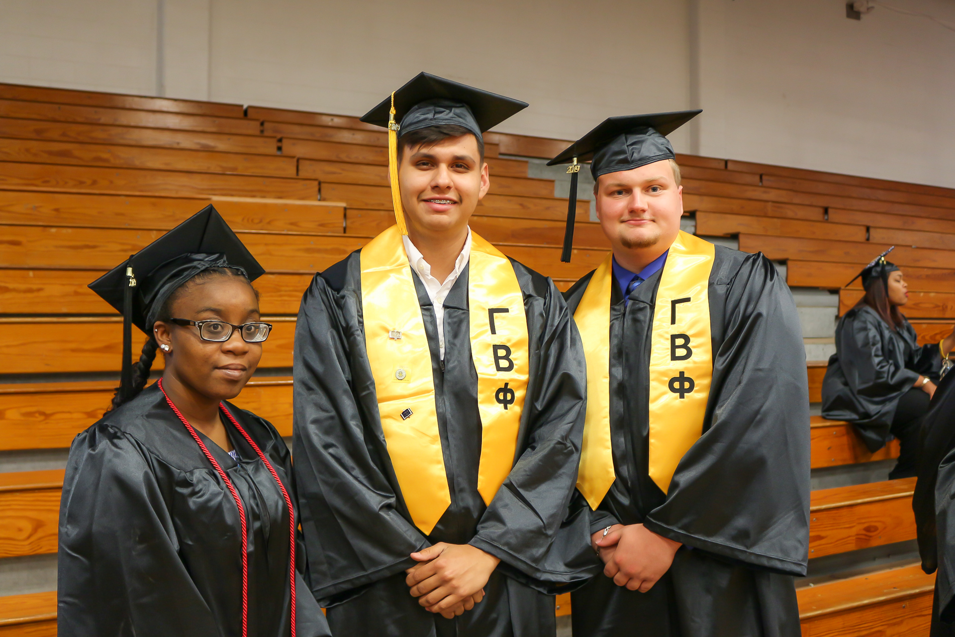 Three students at graduation