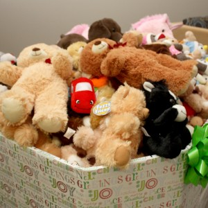 Donation box filled with stuffed animals.