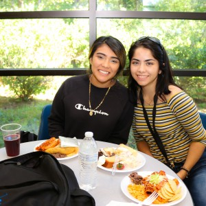 Two students enjoying a meal.