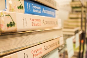 A pile of books reading Corporate Financial